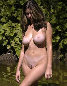Babe with natural breasts on the lake
