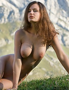 Chick with big boobs near the mountains