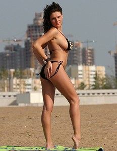 Really sexy big boobed chick on the beach