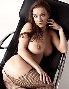 Busty babe in stockings