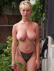 Busty babe in the garden