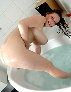 Busty mom undressing in the bathroom