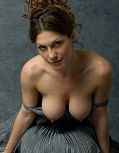 Girl with big breasts in a steel dress