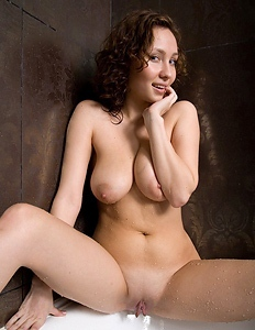 Sweet breasted babe in bath